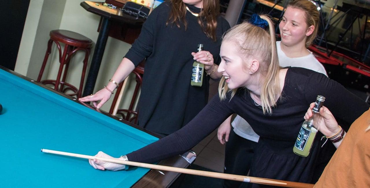 girls playing billard